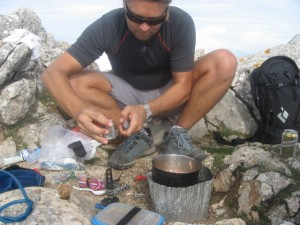Oct 31a, Neil preparing our gourmet lunch on the summit