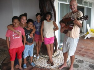 Dec 4: Trying out the new guitar with our little visitors.